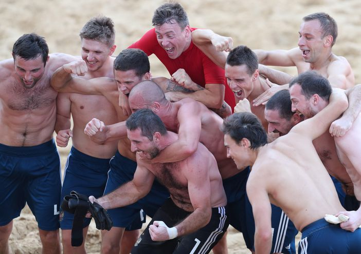 Los jugadores de Rusia celebran el tercer lugar tras vencer a Japón.