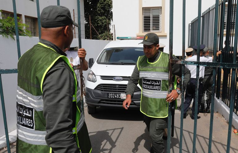 "A van carrying the suspects of murdering two Scandinavian hikers in Morocco leaves the court house in Sale on July 11, 2019. - The trial of the suspected jihadist killers of two Scandinavian women hikers beheaded in Morocco's High Atlas mountains last December neared its close today as lawyers prepared to deliver their final arguments. Prosecutors have called for the death penalty for the three main jihadist suspects behind the ""bloodthirsty"" murder of the young Scandinavians. (Photo by - / AFP)"