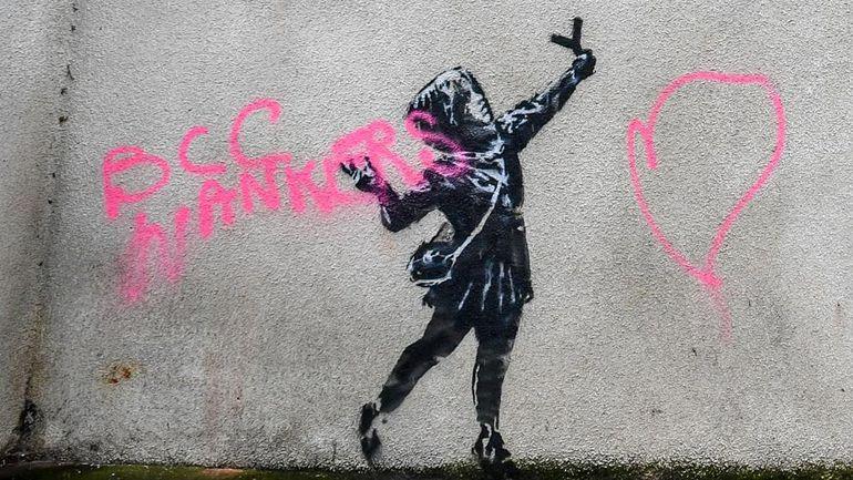Obra de Banksy vandalizada.