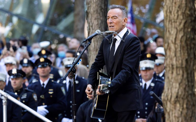 Musician Bruce Springsteen performs a song during a ceremony at the 9/11 Memorial