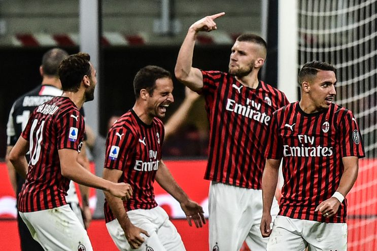 AC Milan's Croatian forward Ante Rebic (2ndR) celebrates after scoring Milan's 4th goal during the Italian Serie A football match AC Milan vs Juventus played behind closed doors on July 7, 2020 at the San Siro stadium in Milan, as the country eases its lockdown aimed at curbing the spread of the COVID-19 infection, caused by the novel coronavirus. (Photo by Miguel MEDINA / AFP)