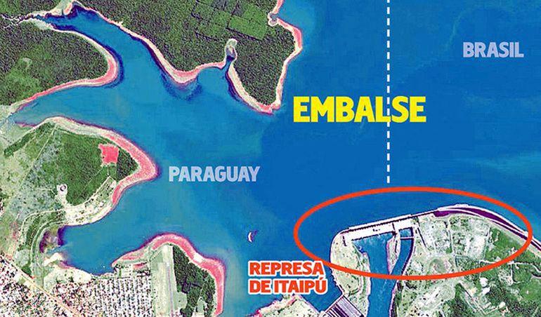 La usina de Itaipú (en círculo), el más grande del mundo en su momento, es casi insignificante frente al río Paraná y el embalse, cuyo valor es incalculable, y sin los cuales la represa no tendría razón de ser (Foto satelital de DigitalGlobe).