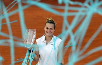 Belarus' Aryna Sabalenka poses with her trophy after beating Australia's Ashleigh Barty during their 2021 WTA Tour Madrid Open tennis tournament singles final match at the Caja Magica in Madrid on May 8, 2021. (Photo by OSCAR DEL POZO / AFP)
