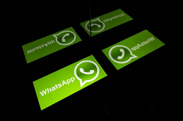 (FILES) In this file photo taken on October 05, 2020 the logo of mobile messaging service WhatsApp on a tablet screen in Toulouse, southwestern France. - WhatsApp on December 8, 2020 added virtual shopping carts people can load with purchases and then use to fire off orders to businesses as the Facebook-owned messaging service pushed deeper into e-commerce. (Photo by Lionel BONAVENTURE / AFP)